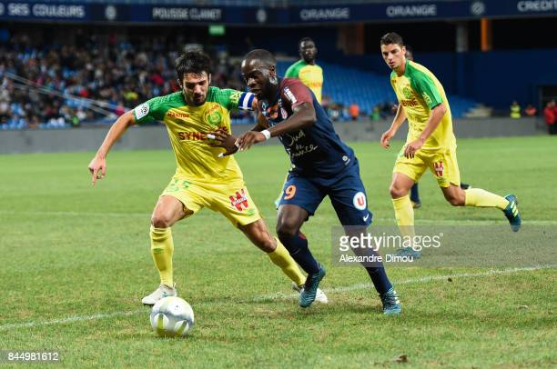 Jonathan Ikone of Montpellier and Leo Dubois of Nantes during the Ligue 1 match between Montpellier Herault SC and Nantes at Stade de la Mosson on...