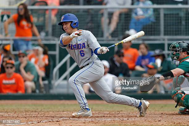 Jonathan India of the Florida Gators hits the ball against the Miami Hurricanes on February 28 2016 at Alex Rodriguez Park at Mark Light Field in...