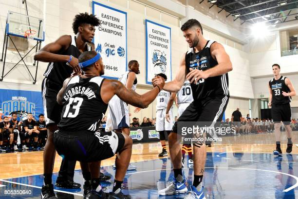Jonathan Isaac and Patricio Garino help up Marcus GeorgesHunt of the Orlando Magic during the game against the Indiana Pacers during the 2017 Orlando...