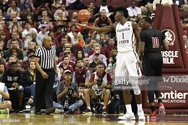 Jonathan Isaac forward Florida State University Seminoles reaches for a rebound against the Louisville Cardinals in an game on January 21 at Donald L...