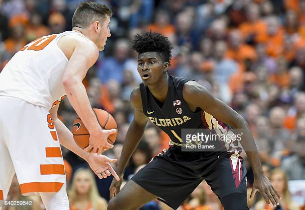 Jonathan Isaac of the Florida State Seminoles defends Tyler Lydon of the Syracuse Orange during the first half at the Carrier Dome on January 28 2017...
