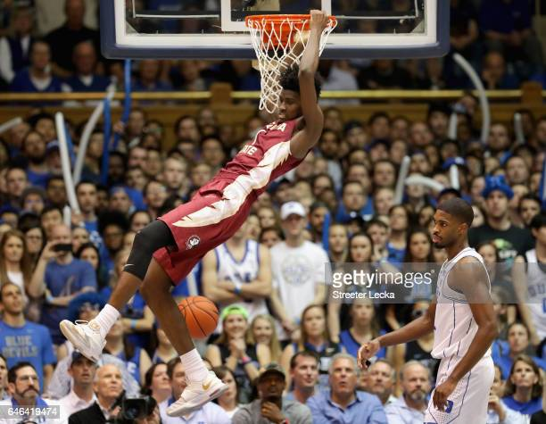Jonathan Isaac of the Florida State Seminoles dunks the ball as Amile Jefferson of the Duke Blue Devils watches on during their game at Cameron...