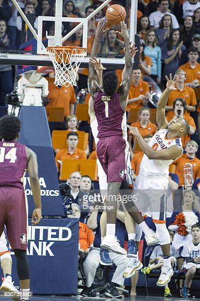 Jonathan Isaac of the Florida State Seminoles goes over Jack Salt of the Virginia Cavaliers during a game at John Paul Jones Arena on December 31...