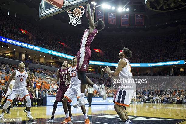 Jonathan Isaac of the Florida State Seminoles jumps to pull in a rebound during Florida's game against the Virginia Cavaliers at John Paul Jones...
