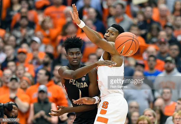 Jonathan Isaac of the Florida State Seminoles passes the ball around Andrew White III of the Syracuse Orange during the second half at the Carrier...