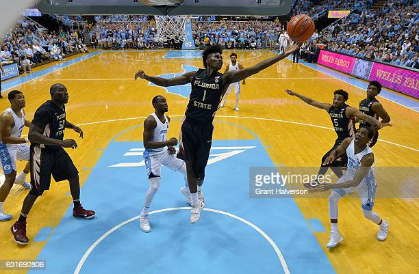Jonathan Isaac of the Florida State Seminoles pulls down a rebound against the North Carolina Tar Heels during the game at the Dean Smith Center on...