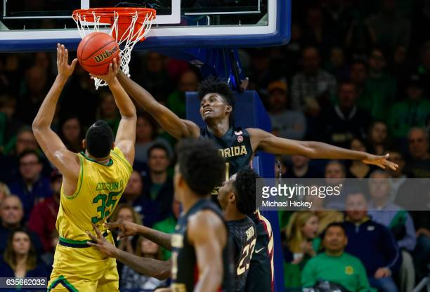 Jonathan Isaac of the Florida State Seminoles reaches for a rebound against Bonzie Colson of the Notre Dame Fighting Irish at Purcell Pavilion on...