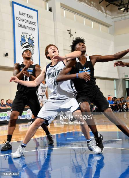 Jonathan Isaac of the Orlando Magic boxes out against Ding Yanyuhang of the Dallas Mavericks on July 3 2017 during the 2017 Summer League at Amway...