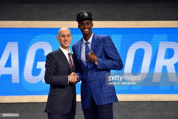 Jonathan Isaac smiles with Adam Silver after being selected sixth overall by the Orlando Magic in the 2017 NBA Draft on June 22 2017 at Barclays...