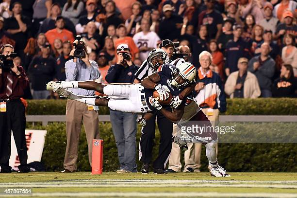 Jonathan Jones of the Auburn Tigers intercepts a pass intended for Shaq Roland of the South Carolina Gamecocks during the fourth quarter of a game at...