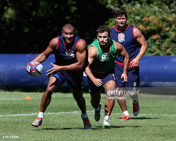Jonathan Joseph moves away from Danny Care during the England training session held at Pennyhill Park on June 30 2015 in Bagshot England