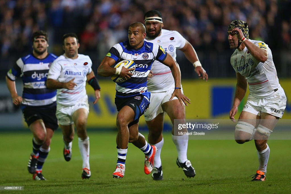 Jonathan Joseph of Bath bursts clear of <a gi-track='captionPersonalityLinkClicked' href=/galleries/search?phrase=Kelly+Brown+-+Rugby+Player&family=editorial&specificpeople=211000 ng-click='$event.stopPropagation()'>Kelly Brown</a> (R) of Saracens to set up his sides second try scored by Kyle Eastmond during the Aviva Premiership match between Bath Rugby and Saracens at the Recreation Ground on October 3, 2014 in Bath, England.