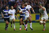 Jonathan Joseph of Bath bursts clear of Kelly Brown of Saracens to set up his sides second try scored by Kyle Eastmond during the Aviva Premiership...