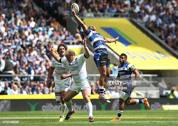 Jonathan Joseph of Bath claims a high ball under pressure from Petrus Du Plessis of Saracens during the Aviva Premiership Final between Bath Rugby...