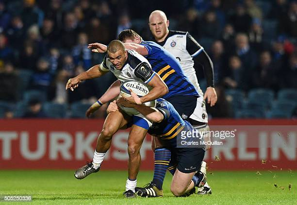 Jonathan Joseph of Bath is tackled by James Tracey of Leinster during the European Champions cup Pool 5 rugby game at the RDS arena on January 16...