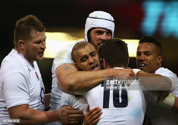 Jonathan Joseph of England celebrates his try with team mates during the RBS Six Nations match between Wales and England at the Millennium Stadium on...