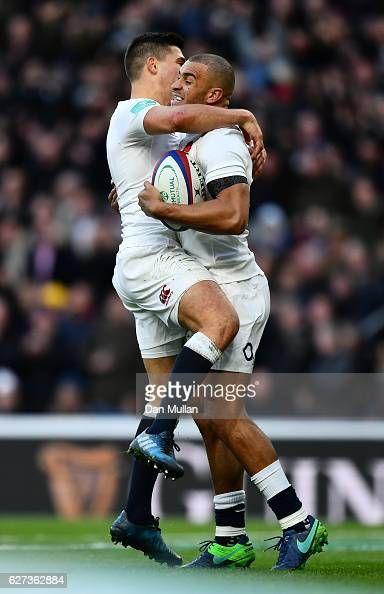 Jonathan Joseph of England celebrates scoring his sides first try with Ben Youngs of England during the Old Mutual Wealth Series match between...