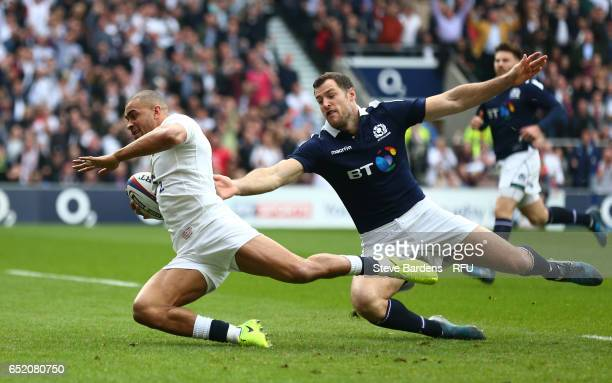 Jonathan Joseph of England dives past Tim Visser of Scotland to score the opening try during the RBS Six Nations match between England and Scotland...