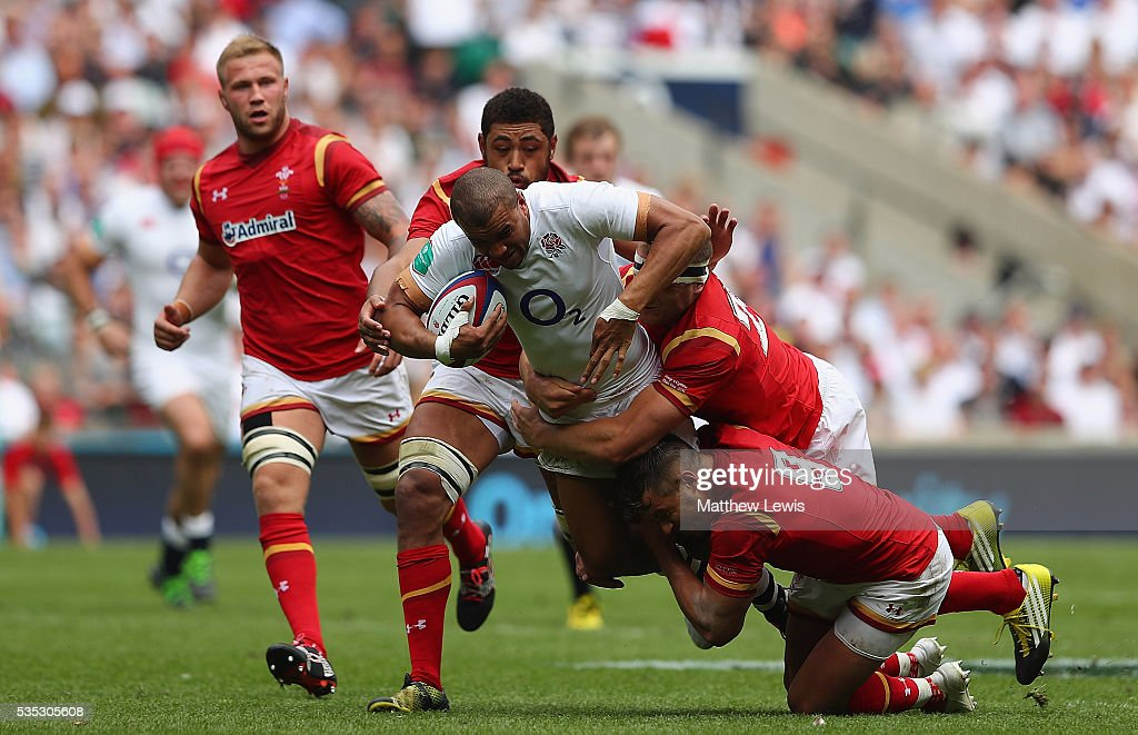 <a gi-track='captionPersonalityLinkClicked' href=/galleries/search?phrase=Jonathan+Joseph+-+Rugby+Player&family=editorial&specificpeople=11460526 ng-click='$event.stopPropagation()'>Jonathan Joseph</a> of England is caught by the welsh defence during an International Friendly match between England and Wales at Twickenham Stadium on May 29, 2016 in London, England.