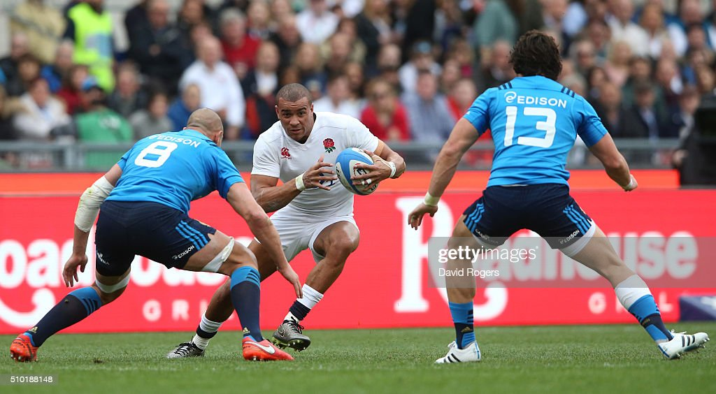 <a gi-track='captionPersonalityLinkClicked' href=/galleries/search?phrase=Jonathan+Joseph+-+Rugbyspelare&family=editorial&specificpeople=11460526 ng-click='$event.stopPropagation()'>Jonathan Joseph</a> of England is challenged by <a gi-track='captionPersonalityLinkClicked' href=/galleries/search?phrase=Sergio+Parisse&family=editorial&specificpeople=648570 ng-click='$event.stopPropagation()'>Sergio Parisse</a> and Michele Campagnaro of Italy during the RBS Six Nations match between Italy and England at the Stadio Olimpico on February 14, 2016 in Rome, Italy.
