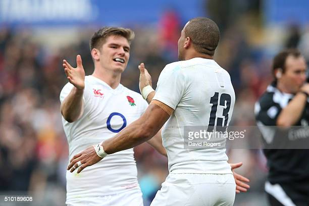 Jonathan Joseph of England is congratulated by teammate Owen Farrell of England after scoring his team's second try during the RBS Six Nations match...