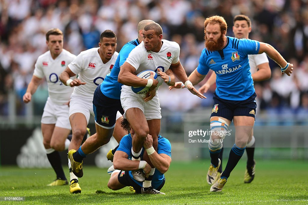 Jonathan Joseph of England is hauled down by the Italy defence during the RBS Six Nations match between Italy and England at the Stadio Olimpico on February 14, 2016 in Rome, Italy.