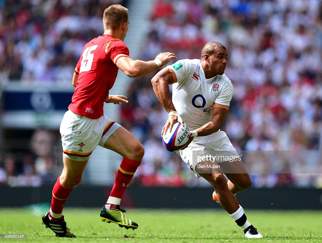 <a gi-track='captionPersonalityLinkClicked' href=/galleries/search?phrase=Jonathan+Joseph+-+Rugby+Player&family=editorial&specificpeople=11460526 ng-click='$event.stopPropagation()'>Jonathan Joseph</a> of England looks for a pass under pressure from <a gi-track='captionPersonalityLinkClicked' href=/galleries/search?phrase=Liam+Williams&family=editorial&specificpeople=7852399 ng-click='$event.stopPropagation()'>Liam Williams</a> of Wales during the Old Mutual Wealth Cup match between England and Wales at Twickenham Stadium on May 29, 2016 in London, England.