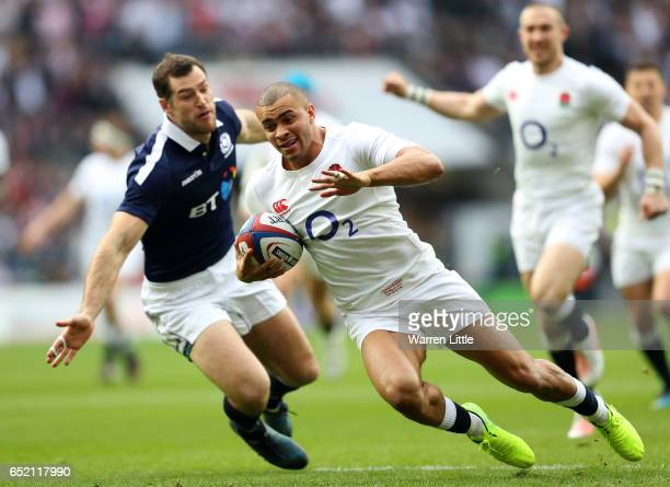 Jonathan Joseph of England scores his sides first try during the RBS Six Nations match between England and Scotland at Twickenham Stadium on March 11...