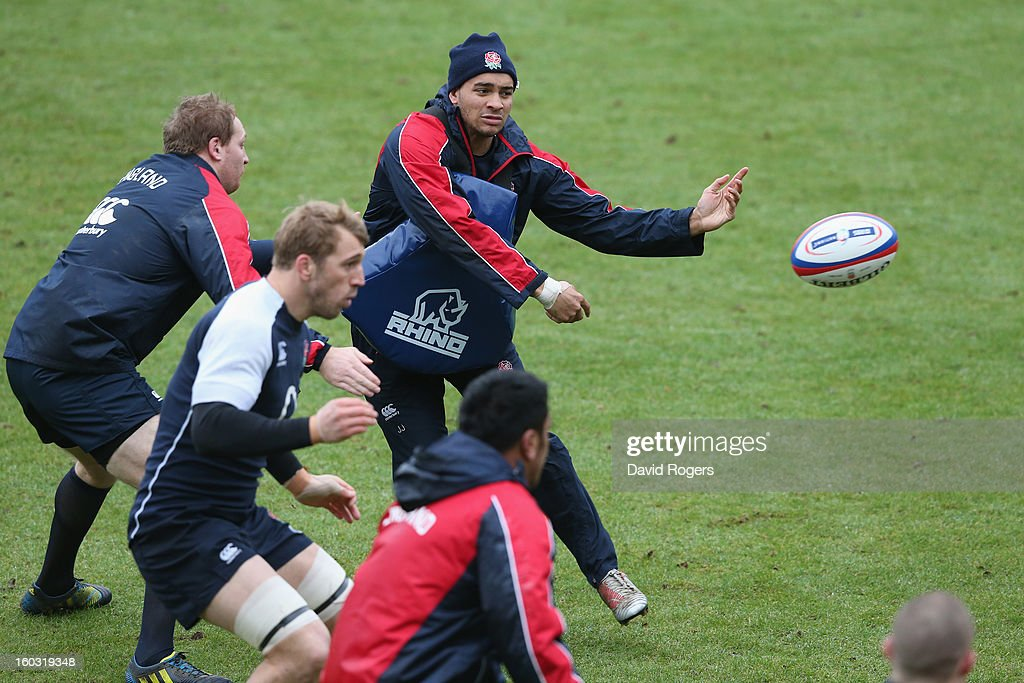Jonathan Joseph passes the ball during the England training session at Pennyhill Park on January 29, 2013 in Bagshot, England.