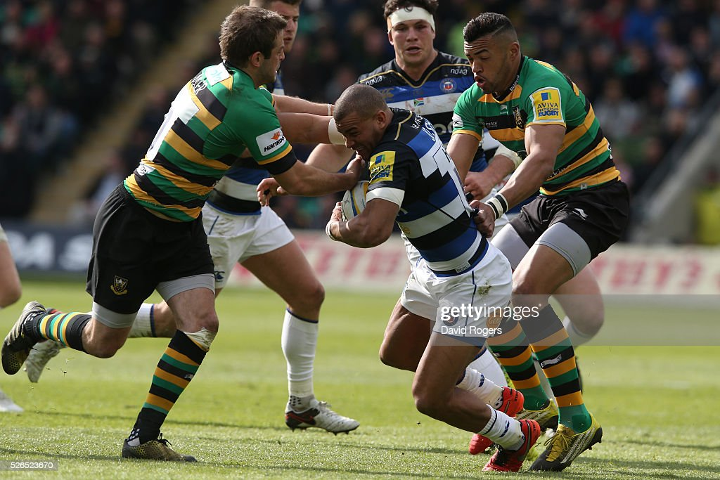 Jonathan Jospeh of Bath is tackled during the Aviva Premiership match between Northampton Saints and Bath at Franklin's Gardens on April 30, 2016 in Northampton, England.