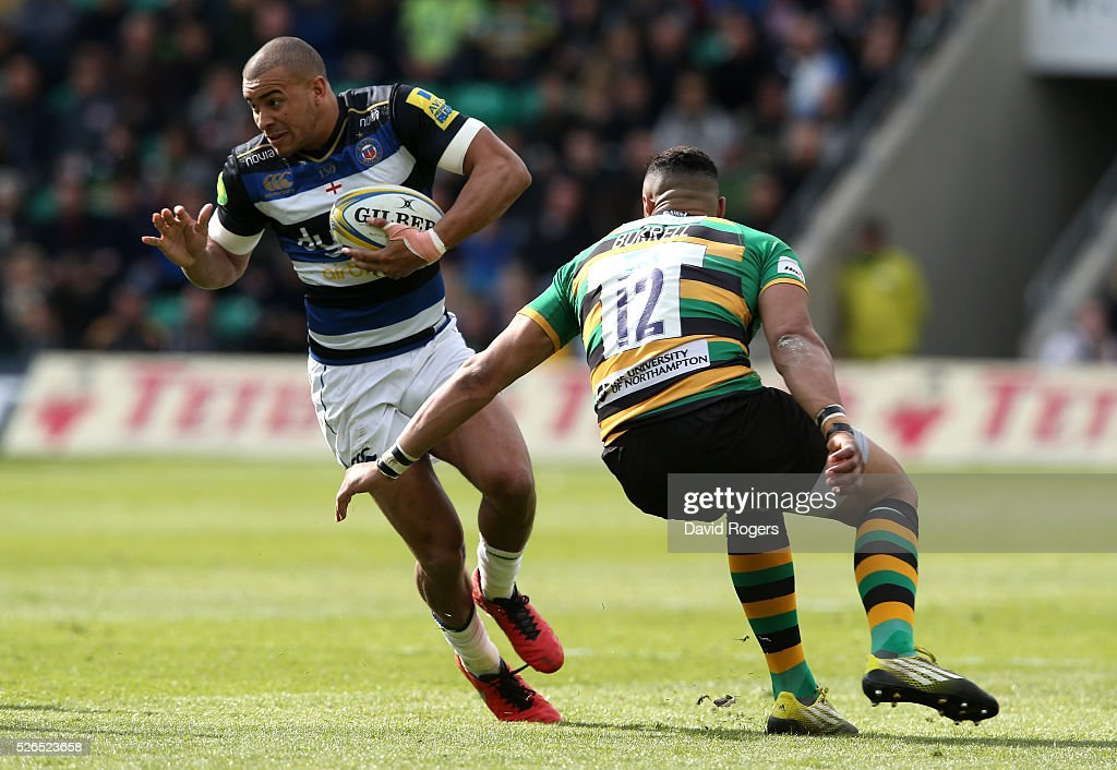 Jonathan Jospeh of Bath moves past Luther Burrell during the Aviva Premiership match between Northampton Saints and Bath at Franklin's Gardens on April 30, 2016 in Northampton, England.