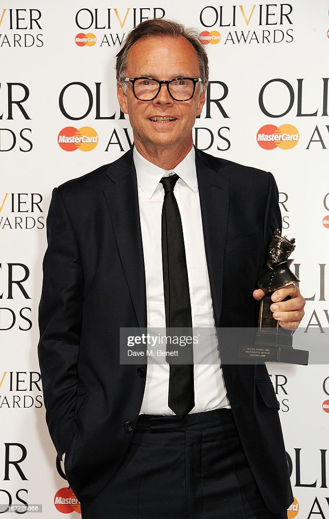 Jonathan Kent, winner of Best Musical Revival for 'Sweeney Todd', poses in the press room at The Laurence Olivier Awards 2013 at The Royal Opera House on April 28, 2013 in London, England.
