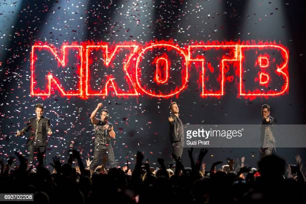 Jonathan Knight Danny Wood Jordan Knight and Joey McIntyre of New Kids on the Block perform during 'The Total Package Tour' at Key Arena on June 7...