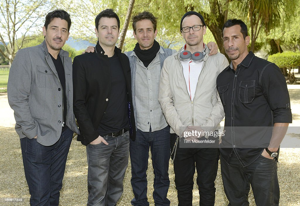 Jonathan Knight, Jordan Knight, Joey McIntyre, Donnie Wahlberg, and Danny Wood of New Kids on the Block pose at Sutter Home Winery as part of Live In The Vineyard on April 6, 2013 in Napa, California.