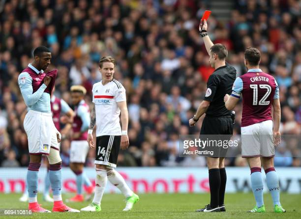 Jonathan Kodija of Aston Villa is shown a red card during the Sky Bet Championship match between Fulham and Aston Villa at Craven Cottage on April 17...