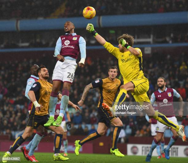 Jonathan Kodja of Aston Villa jumps with goalkeeper Fabian Giefer of Bristol City uring the Sky Bet Championship match between Aston Villa and...