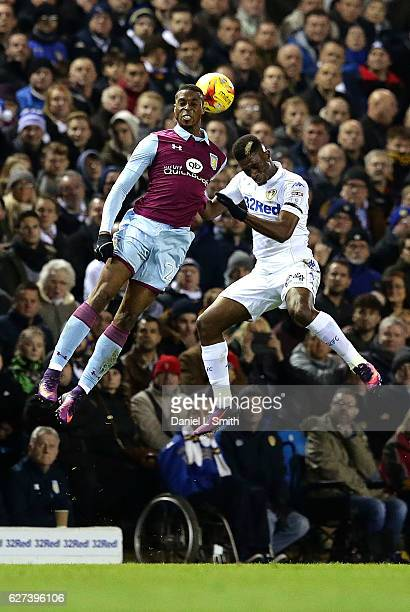 Jonathan Kodjia of Aston Villa and Hadi Sacko of Leeds United compete for the ball during the Sky Bet Championship match between Leeds United v Aston...