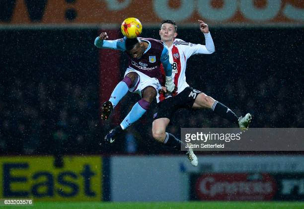 Jonathan Kodjia of Aston Villa and Tom Field of Brentford FC during the Sky Bet Championship match between Brentford and Aston Villa at Griffin Park...