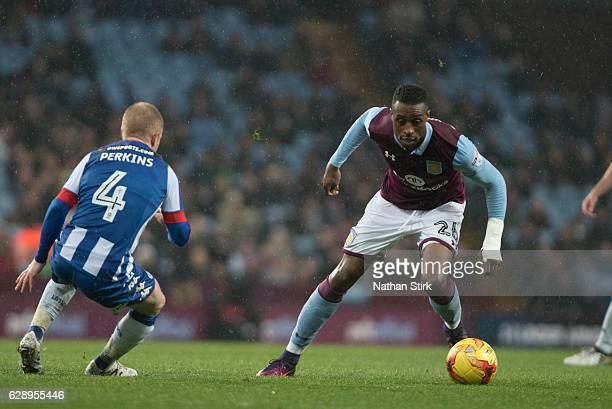 Jonathan Kodjia of Aston Villa andvDavid Perkins of Wigan Athletic in action during the Sky Bet Championship match between Aston Villa and Wigan...