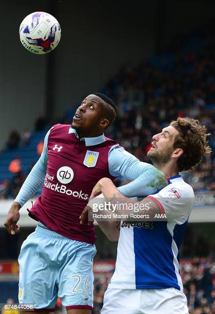 Jonathan Kodjia of Aston Villa competes with Charle Mulgrew of Blackburn Rovers during the Sky Bet Championship match between Blackburn Rovers and...