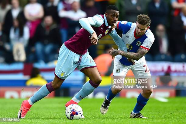 Jonathan Kodjia of Aston Villa competes with Danny Guthrie of Blackburn Rovers during the Sky Bet Championship match between Blackburn Rovers and...