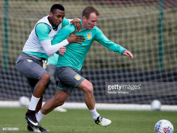 Jonathan Kodjia of Aston Villa in action with team mate Glenn Whelan during a training session at the club's training ground at Bodymoor Heath on...