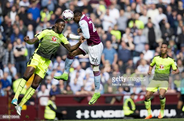Jonathan Kodjia of Aston Villa is challenged by Tyler Blackett of Reading during the Sky Bet Championship match between Aston Villa and Reading at...