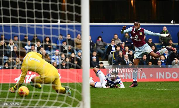 Jonathan Kodjia of Aston Villa scores his side's first goal past Alex Smithies of Queens Park Rangers during the Sky Bet Championship match between...