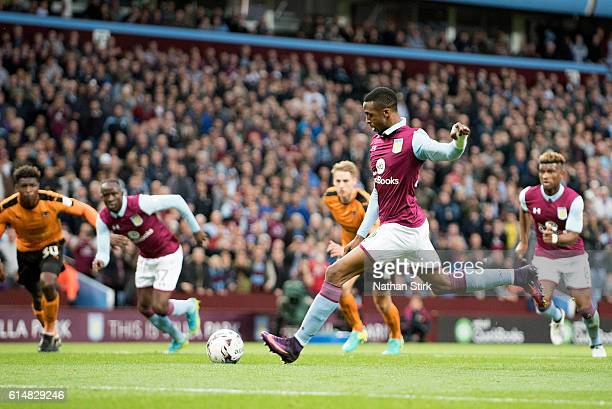 Jonathan Kodjia of Aston Villa scores the opening goal from a penalty during the Sky Bet Championship match between Aston Villa and Wolverhampton...