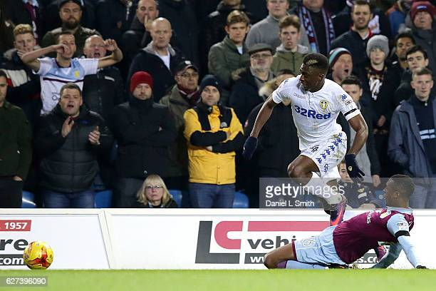 Jonathan Kodjia of Aston Villa slides under Hadi Sacko of Leeds United during the Sky Bet Championship match between Leeds United v Aston Villa at...