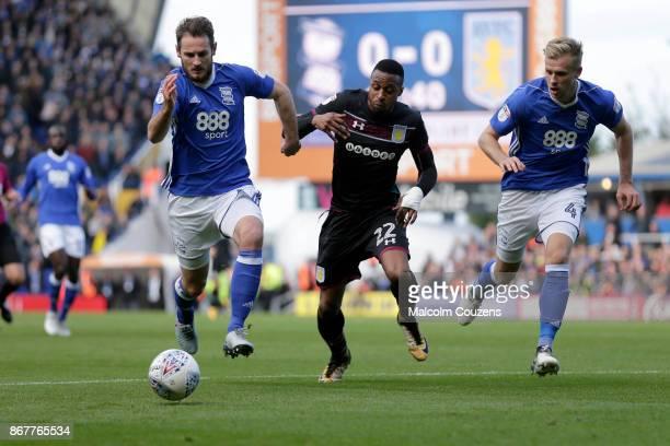 Jonathan Kodjia of Aston Villa takes on Jonathan Grounds and Marc Roberts of Birmingham City during the Sky Bet Championship match between Birmingham...