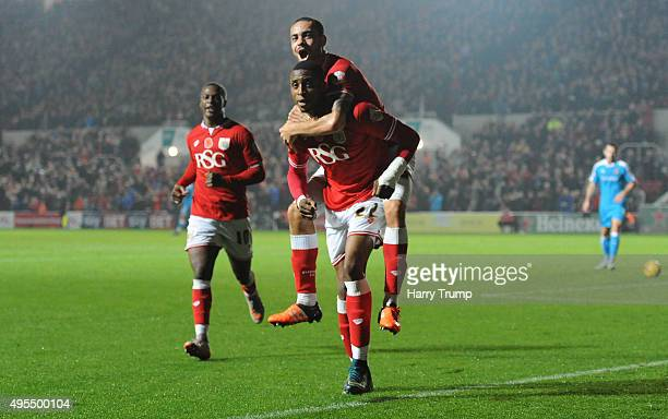 Jonathan Kodjia of Bristol City celebrates his sides goal with Derrick Williams of Bristol City on his shoulders during the Sky Bet Championship...