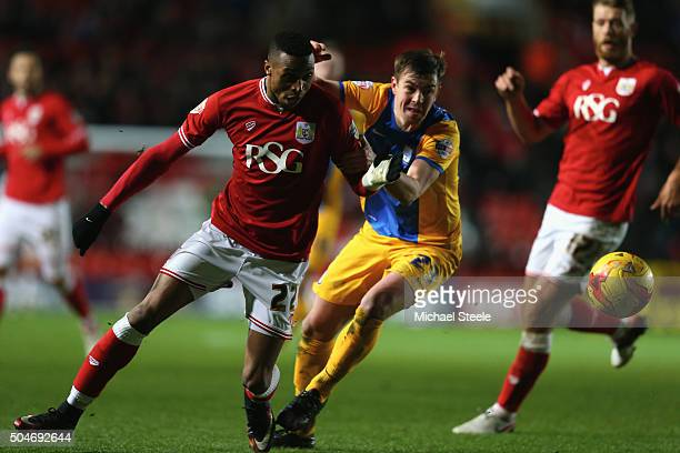 Jonathan kodjia of Bristol City challenged by Paul Huntington of Preston North End during the Sky Bet Championship match between Bristol City and...