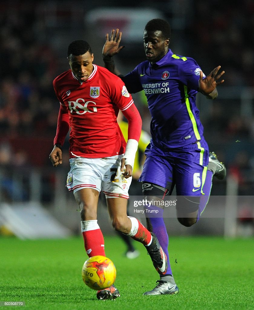 <a gi-track='captionPersonalityLinkClicked' href=/galleries/search?phrase=Jonathan+Kodjia&family=editorial&specificpeople=12805928 ng-click='$event.stopPropagation()'>Jonathan Kodjia</a> of Bristol City is tackled by <a gi-track='captionPersonalityLinkClicked' href=/galleries/search?phrase=Mouhamadou-Naby+Sarr&family=editorial&specificpeople=11332133 ng-click='$event.stopPropagation()'>Mouhamadou-Naby Sarr</a> of Charlton Athletic during the Sky Bet Championship match between Bristol City and Charlton Athletic at Ashton Gate on December 26, 2015 in Bristol, England.